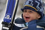 A young boy laughs while skiing at the Canyons in Utah.